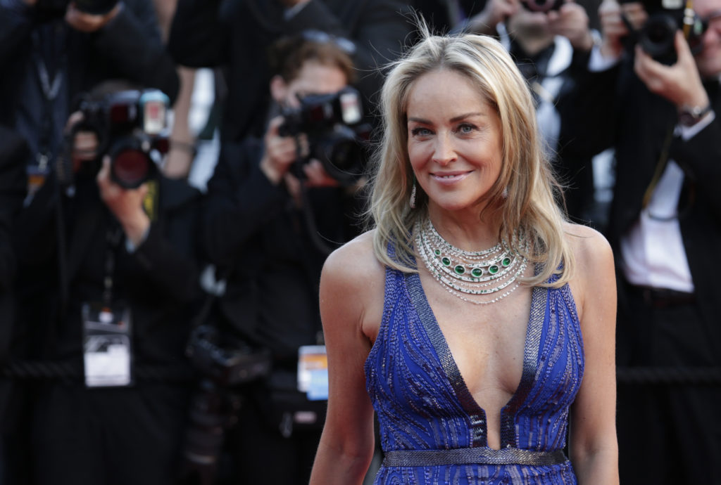 Actress Sharon Stone poses for photographers as she arrives for the screening of Behind the Candelabra at the 66th international film festival, in Cannes, southern France, Tuesday, May 21, 2013. (AP Photo/David Azia)